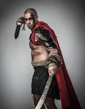 Wounded gladiator with sword Stock Photography