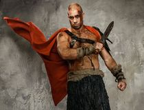 Wounded gladiator with sword Royalty Free Stock Images