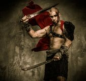 Wounded gladiator with sword Stock Photos