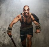 Wounded gladiator with sword Stock Image