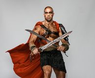 Wounded gladiator with sword Royalty Free Stock Image