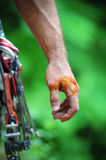 Wounded hand. Climber's wounded hand with camming gear Royalty Free Stock Image