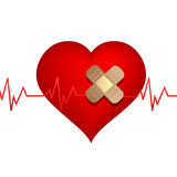 Wounded heart with bandage Stock Photos