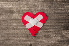 Wounded heart with plaster Royalty Free Stock Images