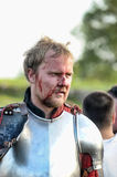 Wounded knight in blood Stock Images