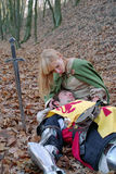 Wounded knight and maid. In forest Royalty Free Stock Photos