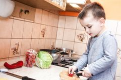 Wounded in the left hand. With bandage boy at shot in home kitchen Stock Photos