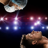 Wounded man and the doctor Stock Images