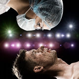 Wounded man and the doctor Royalty Free Stock Image