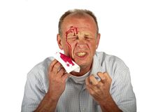 Wounded man with face full of blood. On a white background Stock Photography