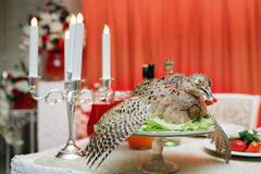 A wounded pheasant hunting. cooked chef to the Banquet. Traditional still life feast.  Royalty Free Stock Photos