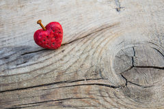 Wounded red heart shape pierced by rusty nail Royalty Free Stock Image