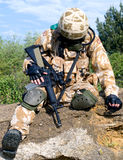 Wounded soldier. British soldier in desert uniform sitting wounded royalty free stock photos