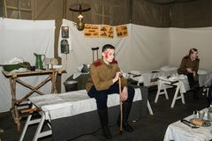 The wounded soldier expects medical care. Expositions of fragments of the military field hospital at the Lenrezerv exhibition Stock Images
