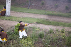 Wounded soldier firing musket Stock Photography
