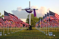 Wounded Warrior Memorial. A display of U.S. Flags and a cross in honor of the many wounded warriors that have served this God and country Royalty Free Stock Images