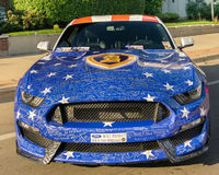 Wounded Warriors Mustang at `Mustang Alley`, at the Woodward Dream Cruise. Stock Photos