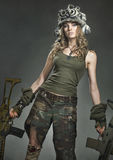 Wounded woman warrior. In a helmet and with a weapon Stock Images