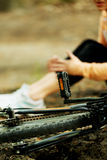 Wounded woman was falled off bicyle.  Stock Photos