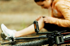 Wounded woman was falled off bicyle Royalty Free Stock Photos