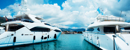 A woundeful yacht is in a blue sea. Traveling, yachting, sailing concept. A woundeful yacht is in a blue sea. Traveling, yachting Royalty Free Stock Photos