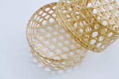 Woven bamboo basket on white background Royalty Free Stock Photo