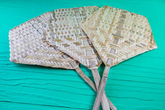Woven bamboo fan. Thai traditional handmade handheld fan Stock Image