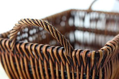 Woven basket. Isolated on the white background Royalty Free Stock Photography