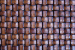 Woven Basket. Close up background texture of a leather woven basket stock photo