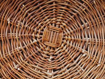 Woven basket bottom. Bottom of a woven basket showing the cratsmanship of the weaver. The center point is where the weaver starts,  weaving the circular bottom Royalty Free Stock Images