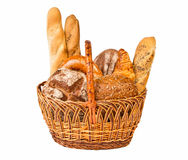 Woven basket with different kind of bread. Isolated on white background Stock Images