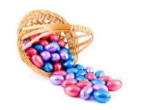 Woven basket with easter eggs Royalty Free Stock Images