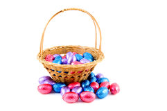 Woven basket with easter eggs Royalty Free Stock Photo