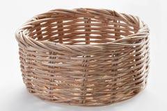 Woven basket. Empty woven basket on white background Stock Photo
