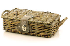 Woven basket with leather and metal lock. On a white background Stock Photography