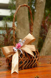 Woven basket with ribbon. On wooden floor Stock Photography