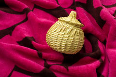 Woven basket on velvet Royalty Free Stock Photo