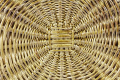 Woven basket wooden background brown wicker Royalty Free Stock Photo