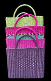 Woven baskets. Colour of four woven baskets isolated on black Royalty Free Stock Photo