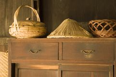 Woven baskets. Traditional Japanese woven baskets on an old wooden cupboard Stock Photography