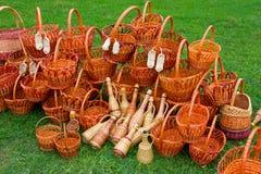 Woven baskets on green grass Stock Photos