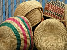 Woven Baskets at Portland, Oregon`s Saturday Market. Plain and colorful woven baskets are for sale during Portland`s Saturday Market royalty free stock images