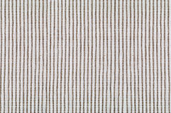 Woven beige fabric texture. Closeup of woven beige fabric texture for background stock images