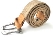 Woven belt. Closeup of woven belt with metal head and leather Stock Image