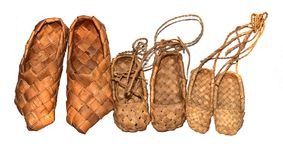 Sneaker wood woven birch sandals for everyday wear in the village on a wooden background Stock Photos