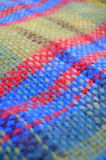Woven Blanket. A Woven Woollen Picnic Blanket With Shallow Depth Of Focus Royalty Free Stock Photos