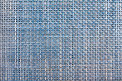 Woven Blue and Cream Colored Background. Closeup of Woven Wicker Place Mat in Blue and Cream Colored Abstract Royalty Free Stock Photography