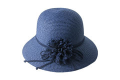 Woven blue hat decorated with flowers made of fabric and rope. Stock Photos