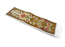 Woven book mark in oriental design. A beautiful woven bookmark in orient easten design.  Style is like a miniature middle eastern carpet.  Ethnic handicraft from Stock Photography
