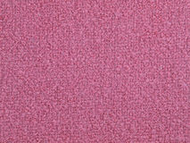 Woven boucle fabric. Pink woolen woven boucle fabric Royalty Free Stock Image
